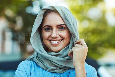 Buy stock photo Portrait of a young beautiful woman wearing a headscarf outside