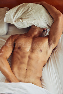 Buy stock photo Shot of an unrecognizable man lying topless on his bed while trying to sleep in the morning at home