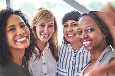 Buy stock photo Cropped shot of a group businesswomen taking a selfie together in the office