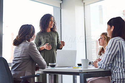Buy stock photo Cropped shot of a group of businesswomen having a meeting in the office