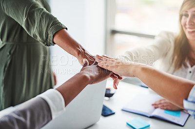 Buy stock photo Cropped shot of unrecognizable businesswomen piling their hands on top of each other in the office