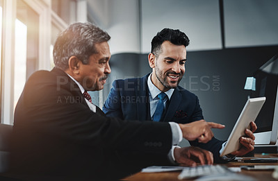 Buy stock photo Cropped shot of colleagues working together in a modern office