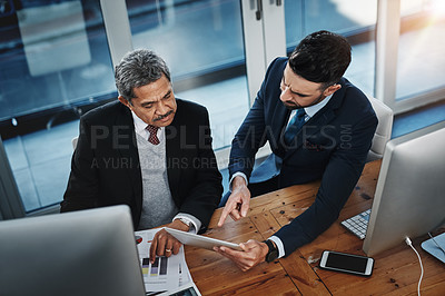 Buy stock photo High angle shot of colleagues working together in a modern office