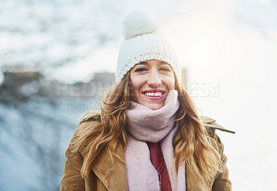 Buy stock photo Portrait of an attractive young woman enjoying being out in the snow