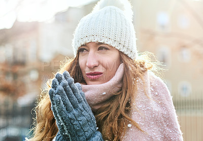 Buy stock photo Shot of an attractive young woman enjoying being out in the snow