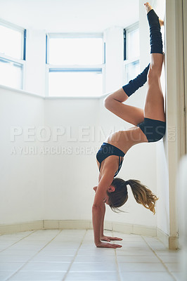 Buy stock photo Full length shot of an attractive young female athlete working out at home