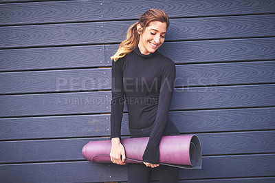 Buy stock photo Cropped shot of an attractive young female athlete carrying her yoga mat
