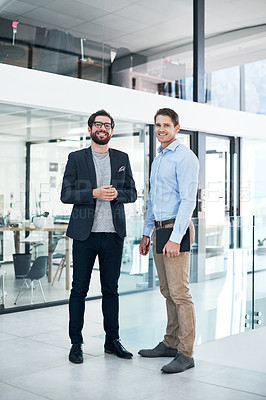 Buy stock photo Portrait of two businessmen standing in an office