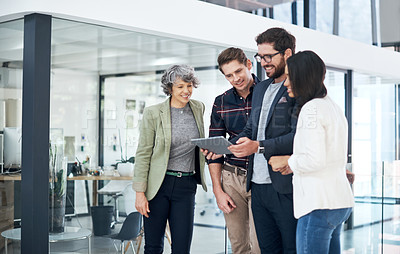 Buy stock photo Shot of businesspeople working together in a modern office