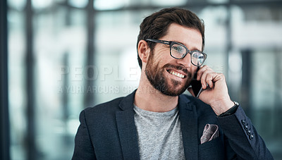 Buy stock photo Shot of a young businessman using a mobile phone in a modern office