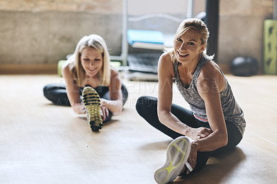 Buy stock photo Shot of mature women working out at the gym