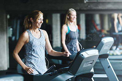 Buy stock photo Shot of mature women working out in the gym