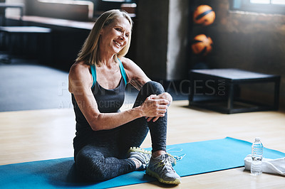 Buy stock photo Full length shot of an attractive mature woman working out in the gym