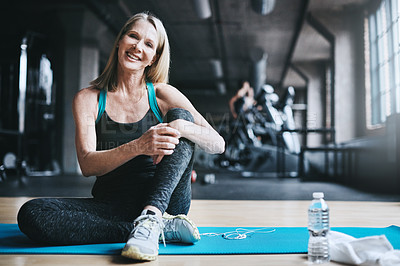 Buy stock photo Full length portrait of an attractive mature woman working out in the gym