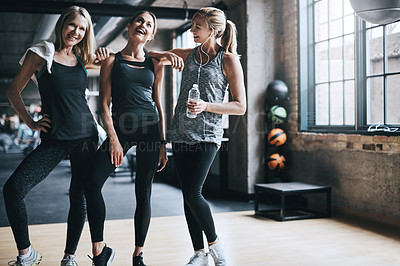 Buy stock photo Full length portrait of three attractive and athletic women working out in the gym
