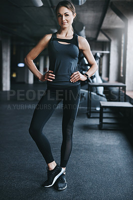 Buy stock photo Full length portrait of an attractive young woman standing with her hands on her hips in the gym