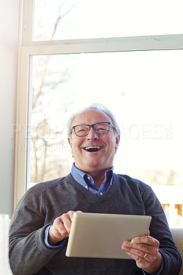 Buy stock photo Cropped shot of a senior man using a tablet at home