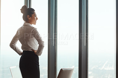 Buy stock photo Shot of a young businesswoman working in a modern office