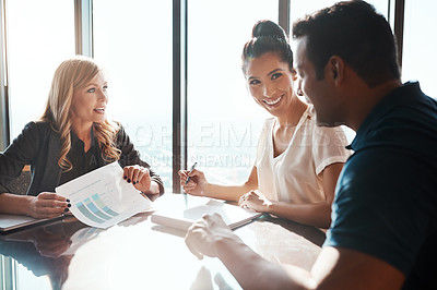 Buy stock photo Shot of a young couple meeting with a financial planner in a modern office