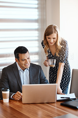 Buy stock photo Cropped shot of two young businesspeople working together in a modern office