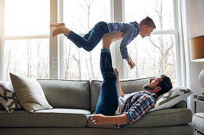 Buy stock photo Shot of a father and his little son having fun at home