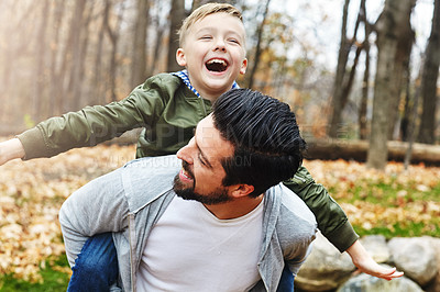 Buy stock photo Shot of a father and his little son  having fun outdoors