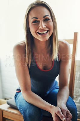 Buy stock photo Cropped portrait of an attractive young sportswoman sitting on a wooden chair