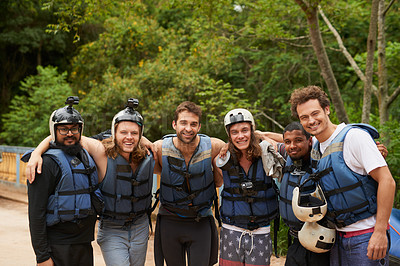 Buy stock photo Portrait of a group of young male friends before going  white water rafting