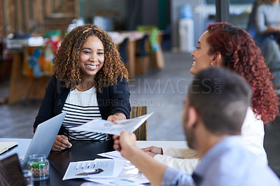 Buy stock photo Cropped shot of an attractive young businesswoman handing over some paperwork to a male colleague during a meeting in the boardroom