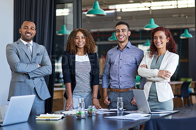 Buy stock photo Cropped portrait of a group of young businesspeople standing in the boardroom