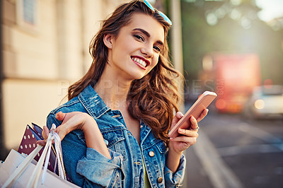 Buy stock photo Cropped shot of a beautiful young woman on a shopping spree in the city