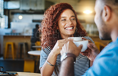 Buy stock photo Cropped shot of an attractive young woman spending time with her boyfriend in a coffee shop