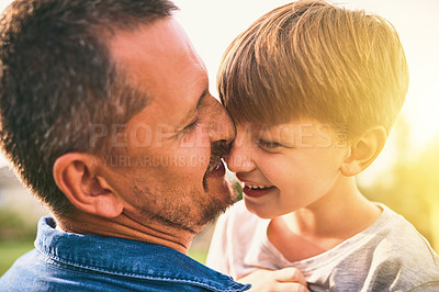 Buy stock photo Shot of a father bonding with his adorable little son outdoors