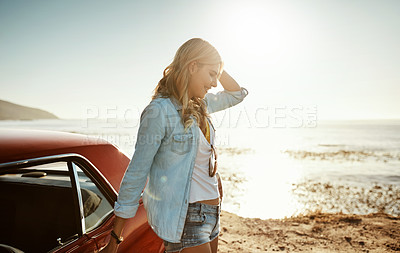 Buy stock photo Shot of a beautiful young woman going on a road trip to the beach