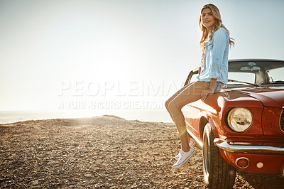 Buy stock photo Portrait of a beautiful young woman relaxing on the hood of her car on a road trip