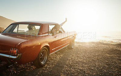 Buy stock photo Shot of a young couple enjoying a road trip together