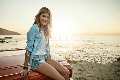 Buy stock photo Portrait of a young woman enjoying a road trip along the coast