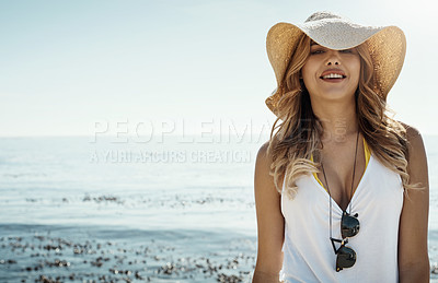 Buy stock photo Portrait of an attractive young woman enjoying her day on the beach