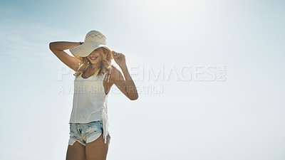 Buy stock photo Shot of an attractive young woman enjoying a summer's day outdoors