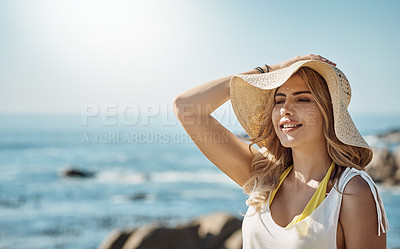 Buy stock photo Shot of an attractive young woman enjoying her day on the beach