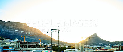 Buy stock photo Shot of the city of Cape Town with Table mountain and Lion's Head in the background during sundown