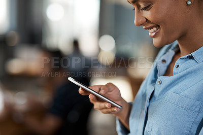 Buy stock photo Shot of an attractive young businesswoman using a cellphone in an office