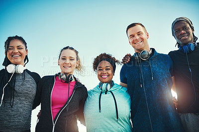 Buy stock photo Portrait of a group of sporty young people standing together outdoors