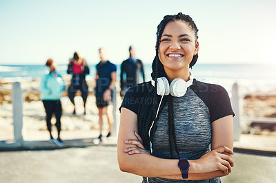 Buy stock photo Portrait of a sporty young woman standing on the promenade