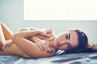 Buy stock photo Cropped shot of a sexy young topless woman posing in her bedroom