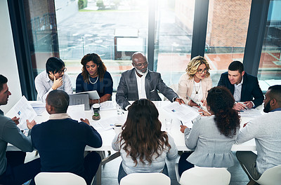 Buy stock photo Shot of a group of diverse businesspeople having a meeting in a modern office