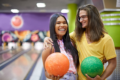 Buy stock photo Portrait of a beautiful young couple on a date in a bowling alley