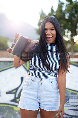 Buy stock photo Portrait of a beautiful young woman at a skatepark outside