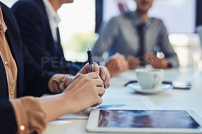 Buy stock photo Cropped shot of a group of businesspeople having a meeting in the boardroom of a modern office