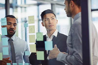 Buy stock photo Shot of a group of young businesspeople having a brainstorming session together in a modern office
